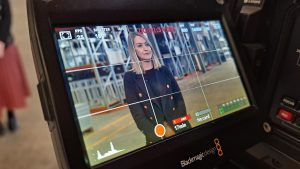 Corporate woman being interviewed as seen on camera monitor screen