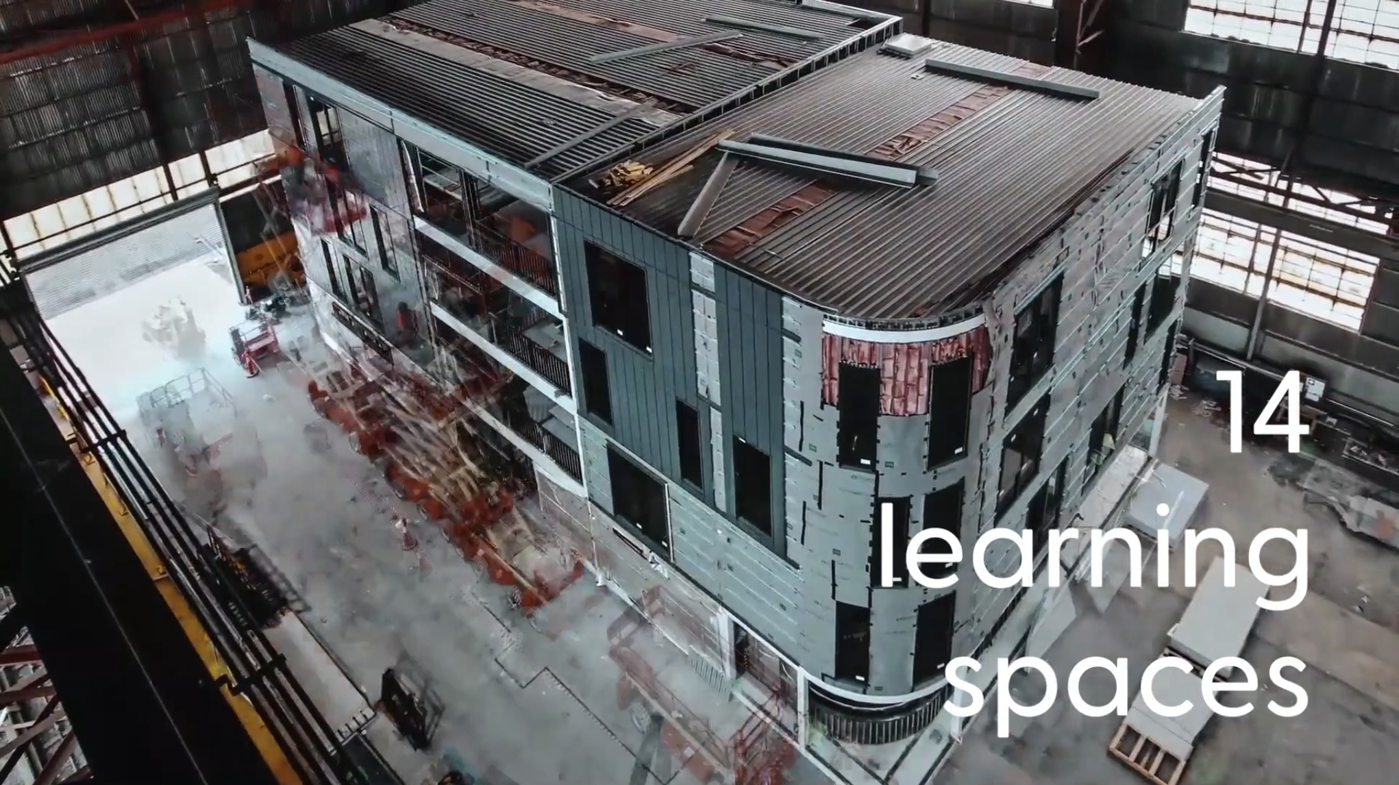 Building under construction with text on screen saying 14 learning spaces